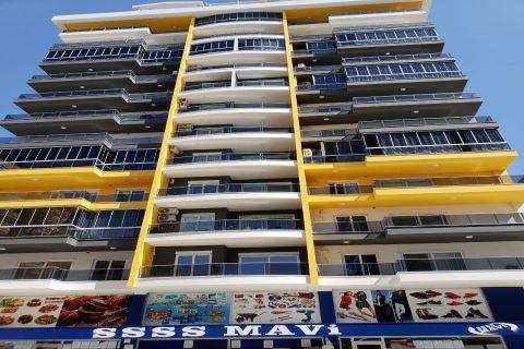 Современная квартира по доступной цене рядом с пляжем в районе Махмутлар, Аланья