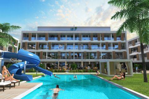 Wysokiej klasy nowe apartamenty w kompleksie przy plaży Otukan na Cyprze
