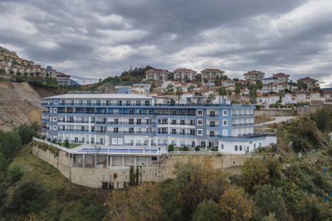 Продаются апартаменты по привлекательной цене в районе Каргыджак, Аланья