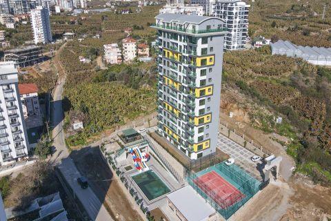 Hoogbouw met betaalbare appartementen in Mahmutlar, Alanya