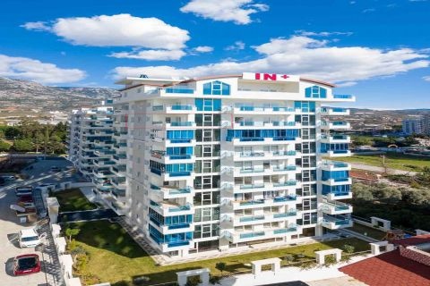 Spacious one-bedroom apartment with sea view in Mahmutlar